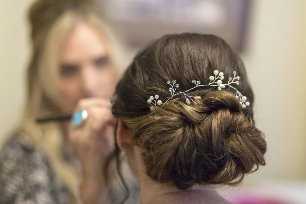 wedding updo with flowers Sonoma Wedding Hotel Depot Restaurant20180421VenessaMarlonWedding-2640